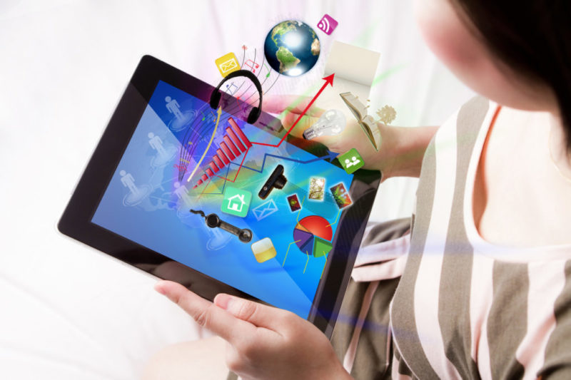 Woman reading the touch screen device (Elements of this image fu
