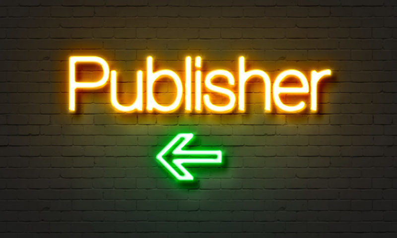 Publisher neon sign on brick wall background.
